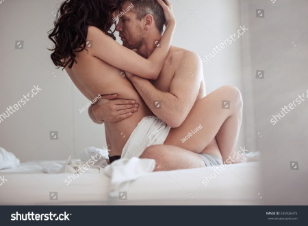 stock-photo-young-couple-having-sex-in-bedroom-sensual-lovers-making-love-in-bed-535926475